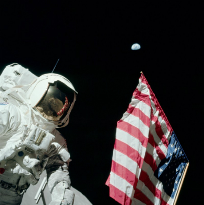 Astronaut Harrison Schmidt, the American flag and home.