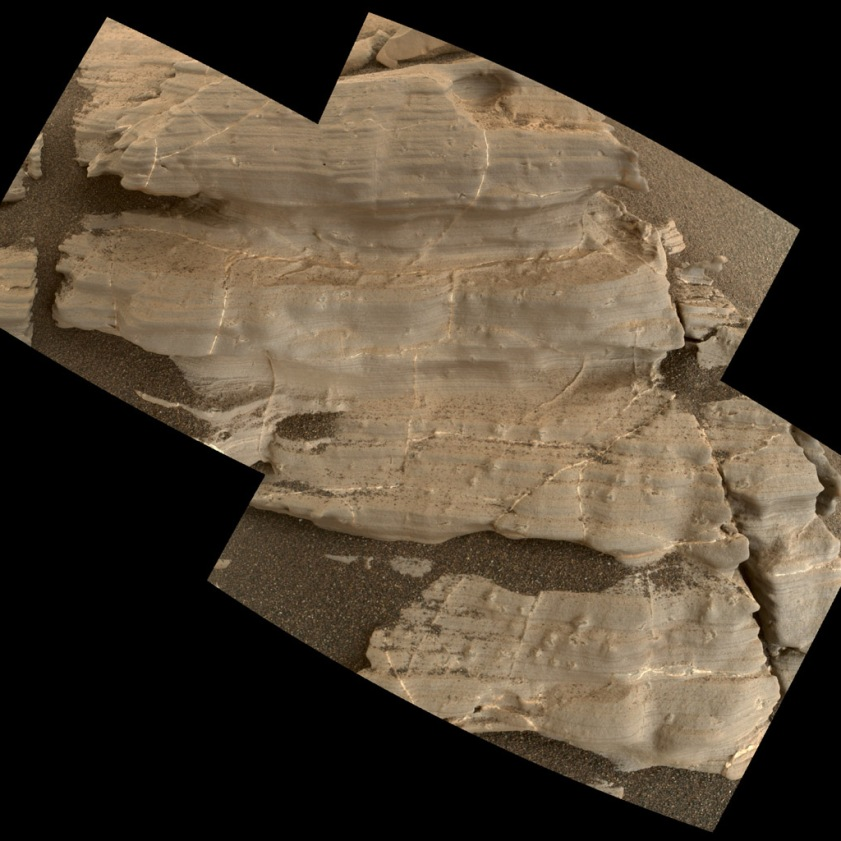 "This exposure of finely laminated bedrock on Mars includes tiny crystal-shaped bumps, plus mineral veins with both bright and dark material. This rock target, called ""Jura,"" was imaged by the MAHLI camera on NASA's Curiosity Mars rover on Jan. 4, 2018, during Sol 1925 of the mission. Credit: NASA/JPL-Caltech/MSSS"