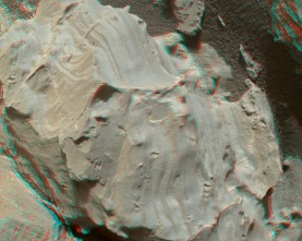 "The surface of the Martian rock target in this stereo, close-up image from the Curiosity rover's MAHLI camera includes small hollows with a ""swallowtail"" shape characteristic of gypsum crystals. The view appears three-dimensional when seen through blue-red glasses with the red lens on the left. Credit: NASA/JPL-Caltech/MSSS"